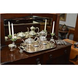 Vintage silver-plate tea service including tea pot, coffee pot, cream and open sugar on large silver