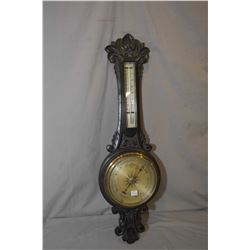Antique heavily carved barometer with mercury Fahrenheit and centigrade thermometer, appears to be i