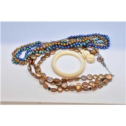 Selection of vintage jewellery including a three strand, multi-coloured pearl necklace, gold coloure