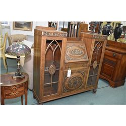 Antique quarter cut oak drop front secretaire flanked by display storage, has fitted interior and ap