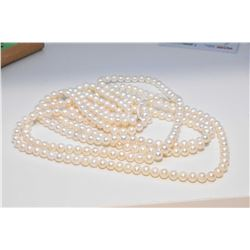 "Single strand of cultured freshwater pearls with 14kt yellow gold clasp, 96"" in length. Retail repla"
