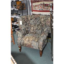 Button tufted upholstered deep winged parlour chair, believe to be Chintz & Co. perfect for reading