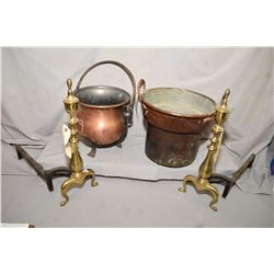 Two vintage copper pots, one with double handles and one footed and a pair of antique brass andirons