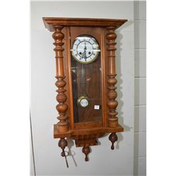Antique chiming wall clock with Roman numerals and decorative pendulum, working at time of catalogui