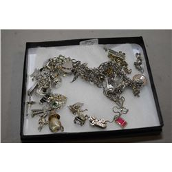 Selection of sterling silver jewellery including charm bracelet with a large selection of loose and