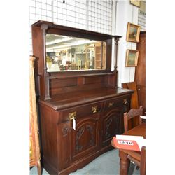 Antique mahogany Tudor style sideboard with raised panelled carved doors and accents and tall back b
