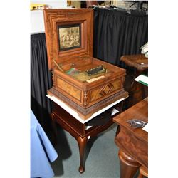 Antique inlaid cased Polyphon double comb table model music box with a large selection of pierced mu