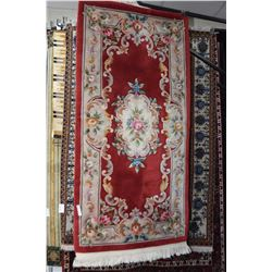 """Sculpted wool area carpet with floral decoration, in shades of red, cream, pinks, greens etc. 36"""" X"""
