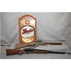 Two vintage bb guns, one is missing the forend and Stroh's illuminated beer sign