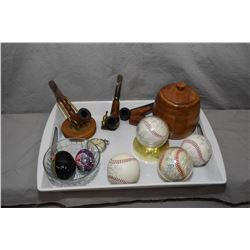 Selection of collectibles including four signed baseballs, wooden humidor, four pipes, two pipe stan