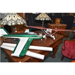 Two flying model airplanes including electrically driven foam Stinson and covered wood gas powered p
