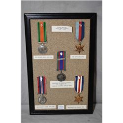 Selection of WWII medals, labelled and mounted on framed corkboard
