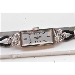Lady's vintage 14kt white gold and diamond Swiss Bulova wrist watch with 17 jewel movement and 0.25c