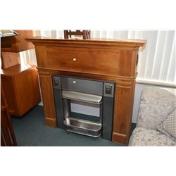 Antique fireplace mantle and pre-depression era metal surround