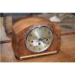 Small deco chiming mantle clock on small bun feet, working at time of cataloguing