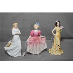 Three Royal Doulton figurines including Georgia HN1588, Loving You HN3389 and Sweeting HN1935