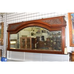"""Antique bevelled wall mirror in carved mahogany frame, overall dimensions 31"""" X 67"""""""