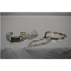 Two sterling bracelets including one with turned brass screw decoration, a silver bangle with abalon