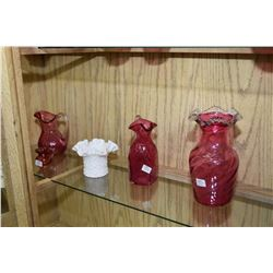 Sixteen pieces of collectible glass including cranberry apples, pitchers, vases, milk glass includin