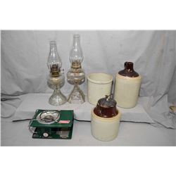 Selection of collectibles including two colourless oil lamps with chimneys, a stoneware jug, lidded
