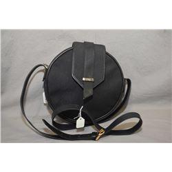 Vintage Yves St. Laurent round navy leather shoulder bag