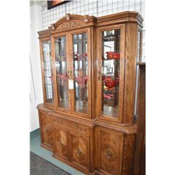 Large semi contemporary chest on chest oak illuminated display cabinet with four doors and two glass