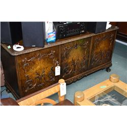 Matched grain European antique low cabinet with applied carved decoration and carved ball and claw f
