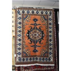 Wool area carpet with center medallion, abstract flora and fauna decoration, pumpkin spice backgroun