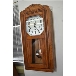 Wall mount oak cased Art Deco chiming wall clock with chrome visible pendulum, trying to work at tim