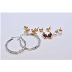Four pairs of gold earrings including 10kt white gold hoops, 14kt yellow gold set with small genuine