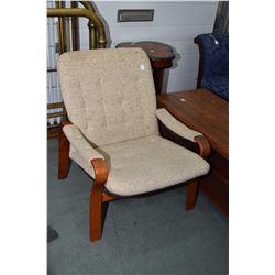 Mid century modern teak framed parlour chair made by Homa of Denmark