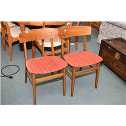 Pair of matching mid century modern teak framed upholstered seat side chairs made in Denmark