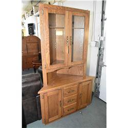 Custom made oak corner cabinet with storage base and display top