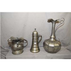 """Three pieces of vintage pewter including Handarveit hod, lidded ewer and a 19"""" high Peltro ewer"""