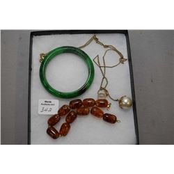 Vintage Amber beaded bracelet with 14kt yellow gold clasp, a green jade bangle and a genuine Chanel