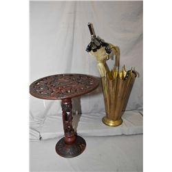 Hand carved African safari motive table and a brass umbrella motif umbrella stands with three umbrel