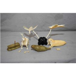 Selection of Inuit carvings, all with small damage including two birds in flight, tusk walrus, soaps