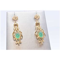 Lady's 14kt yellow gold earrings set with cabochon oval chrysoprase gemstones