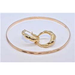 Lady's 10kt yellow gold bangle and a pair of 14kt yellow gold earrings