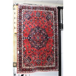 Wool area carpet with large center medallion, overall floral motif, triple border with deep red back