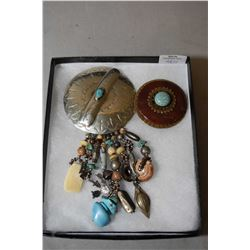 Two vintage David Navarro brooches including concho style medallion set with turquoise gemstones and