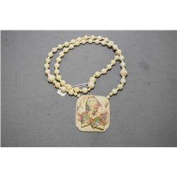 """32"""" beaded necklace with carved and scrimshaw elephant ivory pendant"""