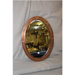 """Art Deco oval bevelled mirror in copper wrapped frame, overall dimensions 28"""" x 20"""""""