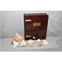 Selection of vintage seashells and a wooden book motif keepsake box with brass hinges