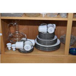 Shelf lot of glassware including handled pitcher, serving bowls, lidded pot, plus a set of Noritake
