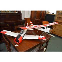 Two model airplanes including a wood and fabric high wing with wheels an skies and a Styrofoam fight