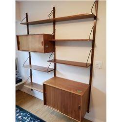 Wall mount adjustable teak wall unit with two cupboard sections, sliding doors and six drawers