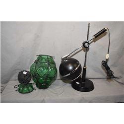 "Mid century ""eyeball"" adjustable desk lamp and a mid century green glass hanging sway encased in met"