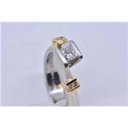 Lady's 18kt yellow gold and platinum diamond engagement ring set with .41ct princess cut center ston