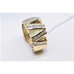 14kt yellow gold custom made diamond ring set with 1.00ct of channel set princess cut diamonds. Reta